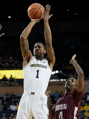 Michigan guard Charles Matthews (1) shoots on Alabama A&M guard Marcus Merriweather (4) in the first half on Thursday, Dec. 21, 2017, at Crisler Center.