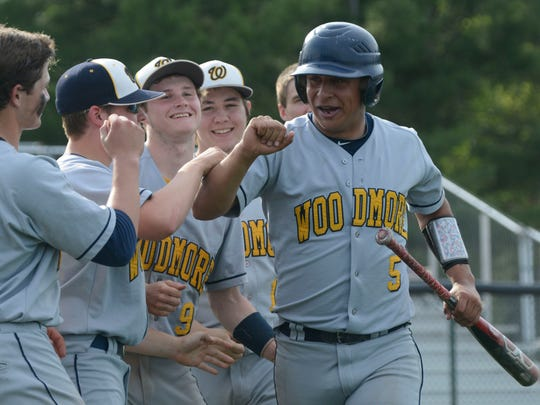 Woodmore's Connor Bringman celebrates a run in the top of the fifth inning.