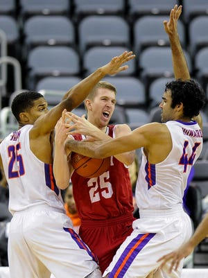 Evansville Aces guard Duane Gibson (25) and Evansville Aces forward David Howard (44) guard Bradley Braves guard Nate Kennell (25) during their game at the Ford Center in Evansville, Wednesday, Jan. 4, 2017. Bradley beat Evansville 74-63.
