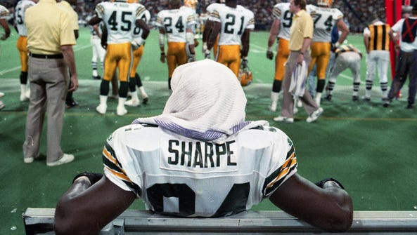 Green Bay Packers receiver Sterling Sharpe (84) sits