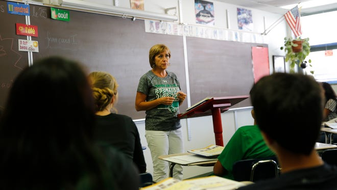 Susan Holman teaches French class Friday at Farmington High School. FHS was one of 15 schools in the Farmington Municipal School District that earned an A or B grade from the state Public Education Department.