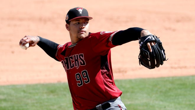 Arizona Diamondbacks starting pitcher Taijuan Walker (99) throws against the Texas Rangers during the second inning of a spring training baseball game, Tuesday, Feb. 28, 2017, in Surprise, Ariz.