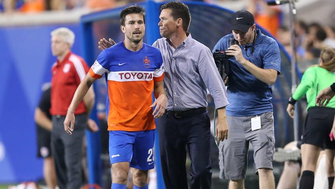 FC Cincinnati head coach Alan Koch pats FC Cincinnati forward Andrew Wiedeman (23) on the back after he is substituted out the game in the second half during the USL soccer match between the New York Red Bulls II and FC Cincinnati, Saturday, Sept. 16, 2017, at Nippert Stadium in Cincinnati. FC Cincinnati won 4-2.