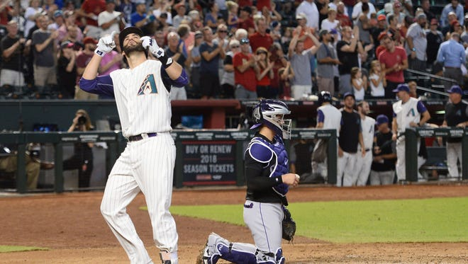 Arizona Diamondbacks right fielder J.D. Martinez (28) celebrates after hitting a solo home run against the Colorado Rockies during the third inning at Chase Field.