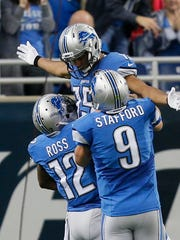 Detroit Lion Jeremy Ross lifts Golden Tate in the air