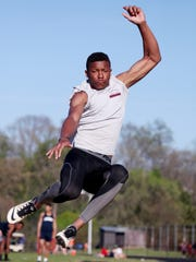 Fishburne's Boubacar Sallah-Mohammed competes in the long jump at the track meet hosted by R.E. Lee on Wednesday, April 20, 2016.