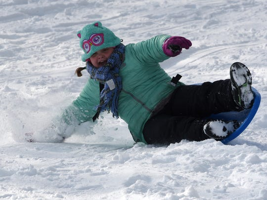 Addy Mathis bails at the bottom of the hill while sledding on Wednesday, Feb. 7,  2018 at Geller Park. Licking County received about four inches of snow resulting in a level two snow emergency in the morning.