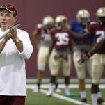 Jimbo Fisher watches over the FSU players as they stretch before a practice last August.