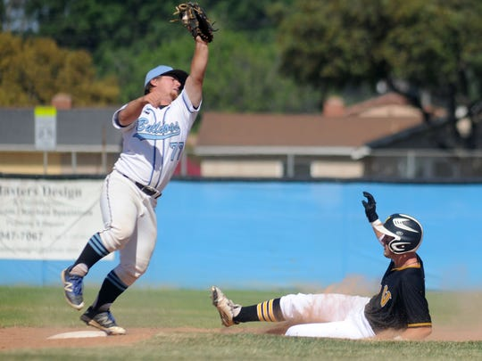Buena High's Ethan Webster stretches to catch a throw as Ventura High's Broc Mortensen slides into second base during a game on May 2. Mortensen was named the Channel League MVP for baseball.