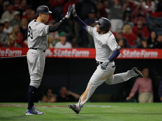 New York Yankees' Miguel Andujar, right, is greeted