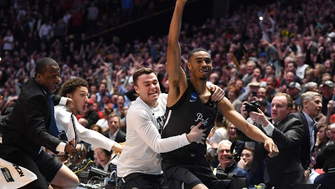 Wolf Pack guard Josh Hall reacts after defeating the Cincinnati Bearcats in the second round of the NCAA Tournament at Bridgestone Arena in Nashville, Tenn., on Sunday.