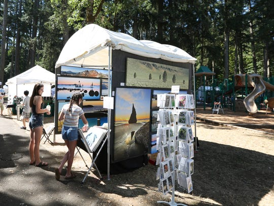 Patrons browse the booths during the 16th annual Silverton