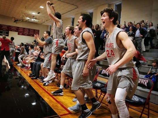 The Rhodes basketball team erupts from the bench after scoring late in their game against Birmingham-Southern to win the SAA Conference Championship Saturday afternoon. The Lynx won 98-95 at Mallory Gymnasium to qualify to the NCAA Division III basketball tournament.