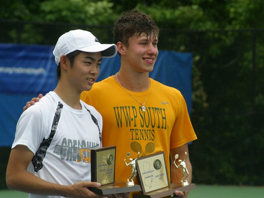 Chikaya Sato is pictured with Robert Siniakowicz after the boys state tennis final.