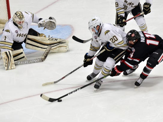 St. Cloud State's Patrick Newell (14) battles Western