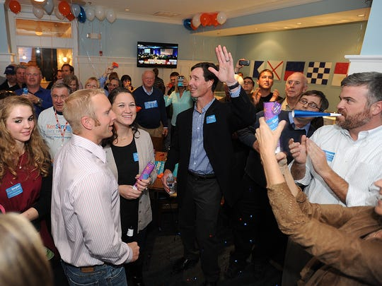 Ken Simpler waves to supporters Tuesday after speaking to Sean Barney at the Avenue Inn in Rehoboth Beach after a day of campaigning for state treasurer. Just over 2,000 votes separated the two candidates in suburban New Castle County, where Democrats typically dominate.