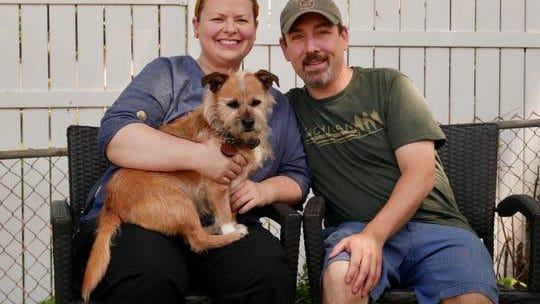 Jeramiah Harrington, 38, and his girlfriend Karasten Birge, 43, and their rescue dog, Bodie, who joined the couple on March 23. Harrington, who lives in Flint Township, was upset to see his credit score drop due to a coronavirus relief glitch associated with some student loans.