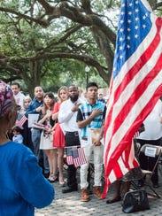 Newly sworn American citizens recite the pledge of
