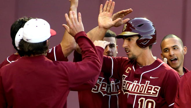 Justin Gonzalez is greeted after scoring as Florida State hosts the NC State Wolfpack in the first of 3 games on Friday night.