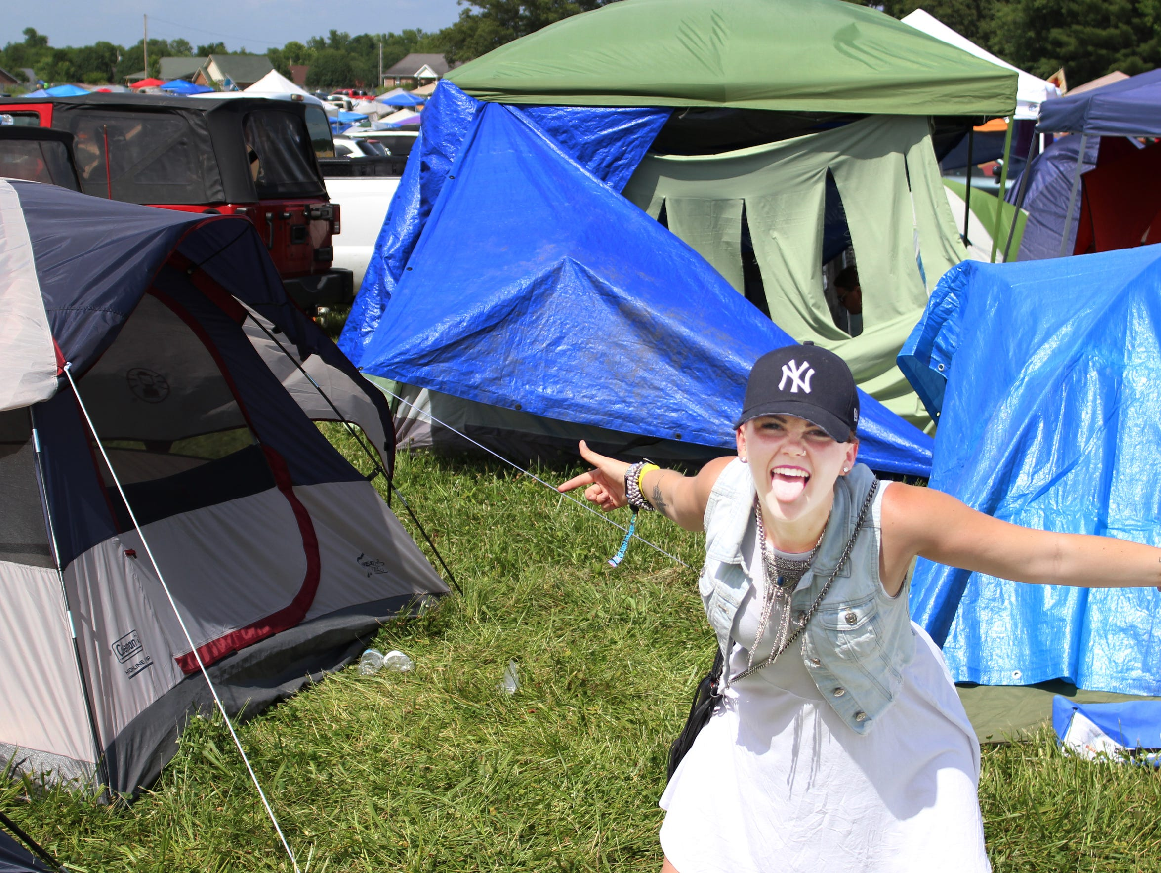 A Bonnaroovian poses at a campsite.