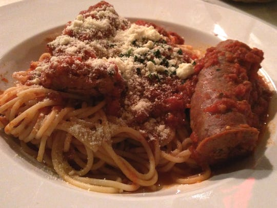 The Original Mama Mia's Kitchen's chicken parmigiana, spaghetti and sausage were very good Italian-American staples.