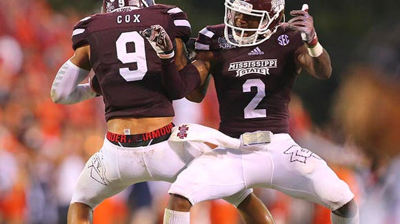 Oct 11, 2014; Starkville, MS, USA; Mississippi State Bulldogs defensive back Will Redmond (2) and Mississippi State Bulldogs defensive back Justin Cox (9) celebrate after a reception during the game against the Auburn Tigers at Davis Wade Stadium. Mississippi State Bulldogs defeated the Auburn Tigers 38-23.  Mandatory Credit: Spruce Derden-USA TODAY Sports
