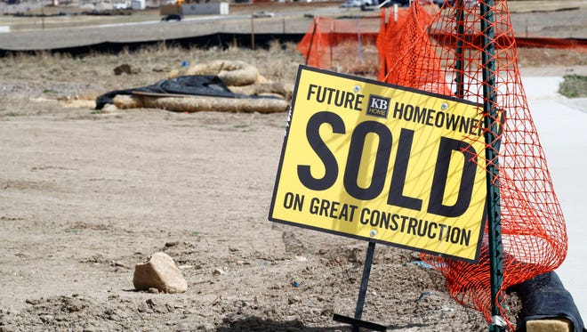A sign stands at the site of a yet-to-be-constructed new home in Castle Rock, Colo. Higher mortgage rates are making the already challenging task of buying an affordable home even tougher for many Americans this spring.