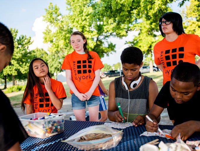 Creative York student volunteers look on as Christopher
