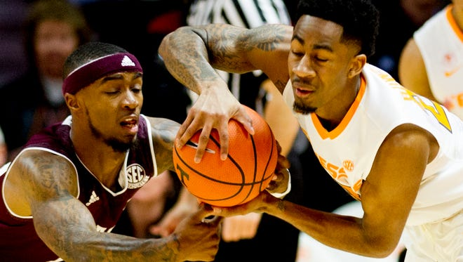 Tennessee guard Jordan Bowden (23) and Texas A&M guard JJ Caldwell (4) battle for possession of the ball during a game between Tennessee and Texas A&M at Thompson-Boling Arena in Knoxville, Tennessee on Saturday, January 13, 2018.