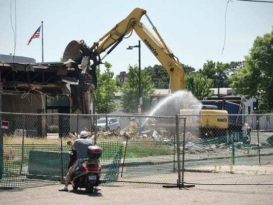 Demolition work continues Thursday, July 6, on the east side of St. Cloud.