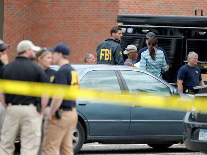 Law enforcement officials investigate an explosion