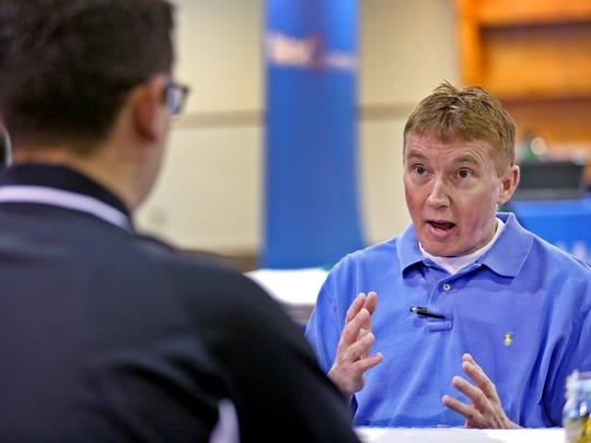 Bob Cunningham, right, from Fishers, interviews with Samuel Barajas at the Walmart job fair, Tuesday, May 15, 2018.  Walmart  is having a two-day job fair May 15 and 16 at the Indiana State Fairgrounds, in Grand Hall, from 10am-8pm.  They are hoping to fill jobs in the Plainfield store.
