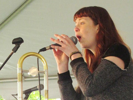 """Natalie Cressman sings one of her own compositions with her """"pirate jazz"""" band Saturday in City Hall Park for the Burlington Discover Jazz Festival."""