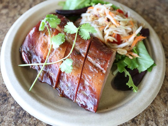Smoked Baby Back Ribs with side Papaya Salad ($12) at Big Blue Thai BBQ food truck on Thursday, March 24, 2016, in Salem.