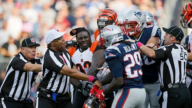 Bengals defensive tackle Pat Sims and Patriots running back LeGarrette Blount exchange shoves after a play in the fourth quarter.