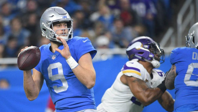 Detroit Lions quarterback Matthew Stafford (9) drops back to pass during the first quarter against the Minnesota Vikings at Ford Field.