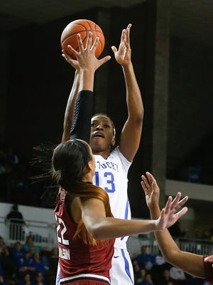 Kentucky Wildcats forward Evelyn Akhator puts up a shot over South Carolina Gamecocks forward A'ja Wilson during the first half at Memorial Coliseum in Lexington, Ky on February 2, 2017.