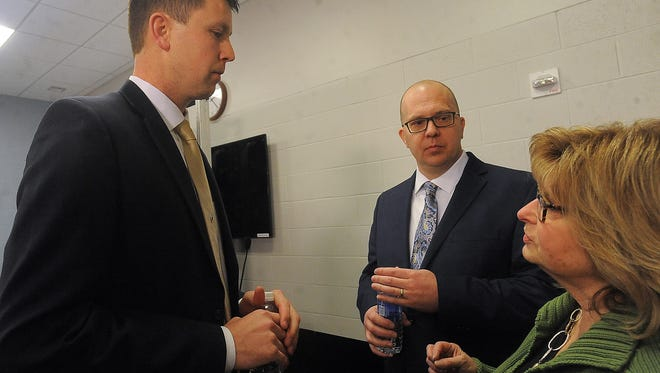 Bryan Miller (left), executive director of the Sioux Falls Sports Authority, talks with Denny Sanford Premier Center's general manager Terry Torkildson (center) and Sioux Falls Convention and Visitors Bureau's executive director Teri Schmidt after a press conference at the Denny Sanford Premier Center on Thursday, March 3, 2016.