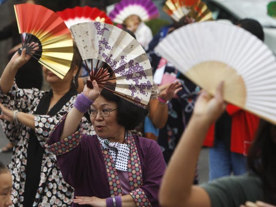 Dancers perform the Obon Dance during the Obon Festival Sunday at the Buddhist Temple of Salinas.