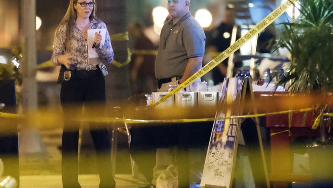 Fort Myers police Chief Dennis Eades, right, joined detectives in working the scene of a fatal shooting Saturday during ZombiCon in downtown Fort Myers. A man was killed and five others wounded Saturday in the shooting.