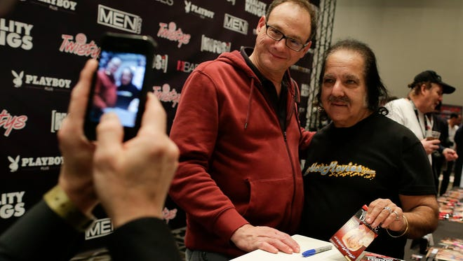 Porn star Ron Jeremy poses for a photo with a fan while signing autographs during the Adult Entertainment Expo, Wednesday, Jan. 15, 2014, in Las Vegas. 7