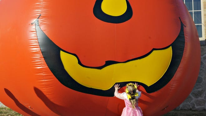 A large inflatable pumpkin was an attraction as an earlier Pumpkinfest in St. Cloud.