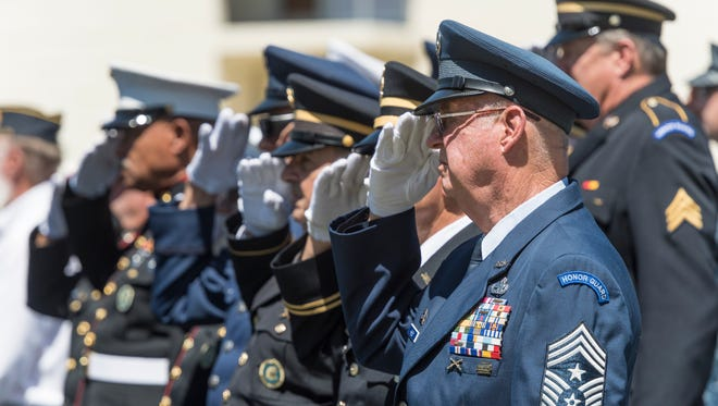 Dean Harley, a member of Joint Service Honor Command, joins others  in remembering the Battle of Midway during the annual commemoration at Naval Air Station Lemoore on Monday, June 4, 2018.