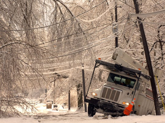 A SERCO utility truck is stuck in a ditch and abandoned on McConnel Avenue south of Covert Avenue as utility crews work the neighborhood to restore power during the January 2009 ice storm.
