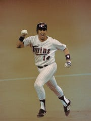 ** FILE ** Minnesota Twins' Kent Hrbek reacts as he rounds the bases in the Minneapolis Metrodome, Oct. 24, 1987, during Game 6 of the World Series against the St. Louis Cardinals, after hitting a sixth-inning grand slam home run.The Twins gather this weekend for the 20th anniversary of the team's first World Series title. (AP Photo/Rusty Kennedy,file)
