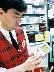An unidentified Tokyo salesperson plays with Nintendo's