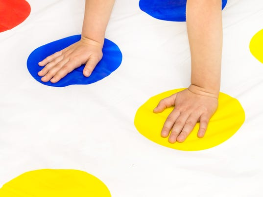 Child's hands on twister game