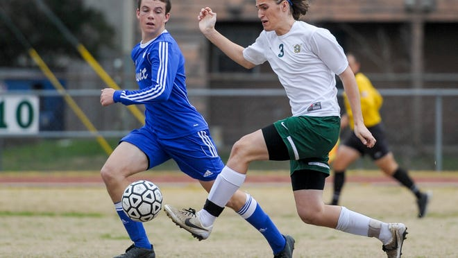 Acadiana's Bailey Deroussel (3) handles a loose ball during Saturday's Division I state semifinals soccer match against Jesuit of New Orleans at Bill Dotson Stadium.