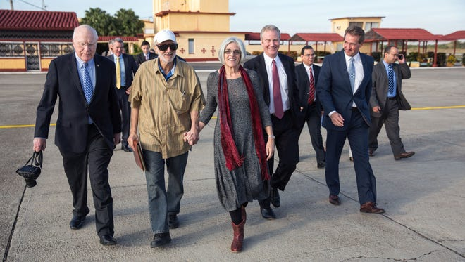 Alan Gross on the tarmac with his wife, Judy Gross, attorney Scott Gilbert, Sen. Jeff Flake, R-Az., Sen. Patrick Leahy, D-Vt., and Rep. Chris Van Hollen, D-Md., during his release at an airport near Havana on Wednesday. Gross was released after spending five years in a Cuban prison.