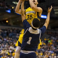 Marquette Golden Eagles guard Haanif Cheatham (25) shoots over Jackson State Tigers guard Chace Franklin (1) during the first half at BMO Harris Bradley Center.